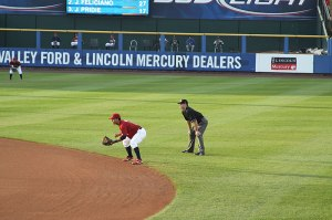 photo of infielder and umpire