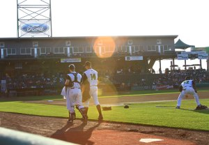 Photo of catcher and pitcher walking to the field