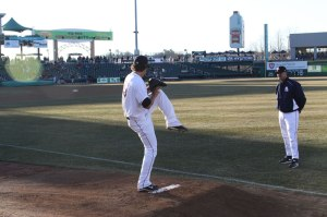 Photo of pitcher and coach