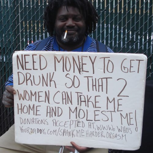 Photo of man with sign
